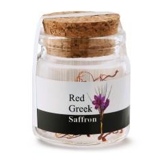 Safran grec en pistils 0,5g dans un pot de verre avec bouchon de liège, vue de face