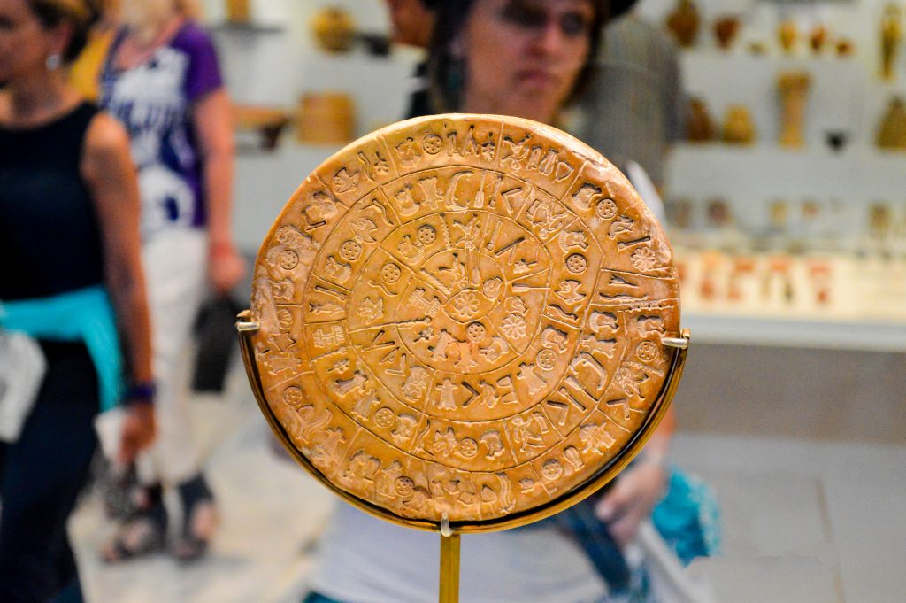 The Phaistos Disc, a disk of fired clay from the Minoan Palace of Phaistos exposed at Heraklion Archeological Museum in Crete, Greece.