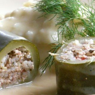 stuffed zucchinis in an avgolemono sauce
