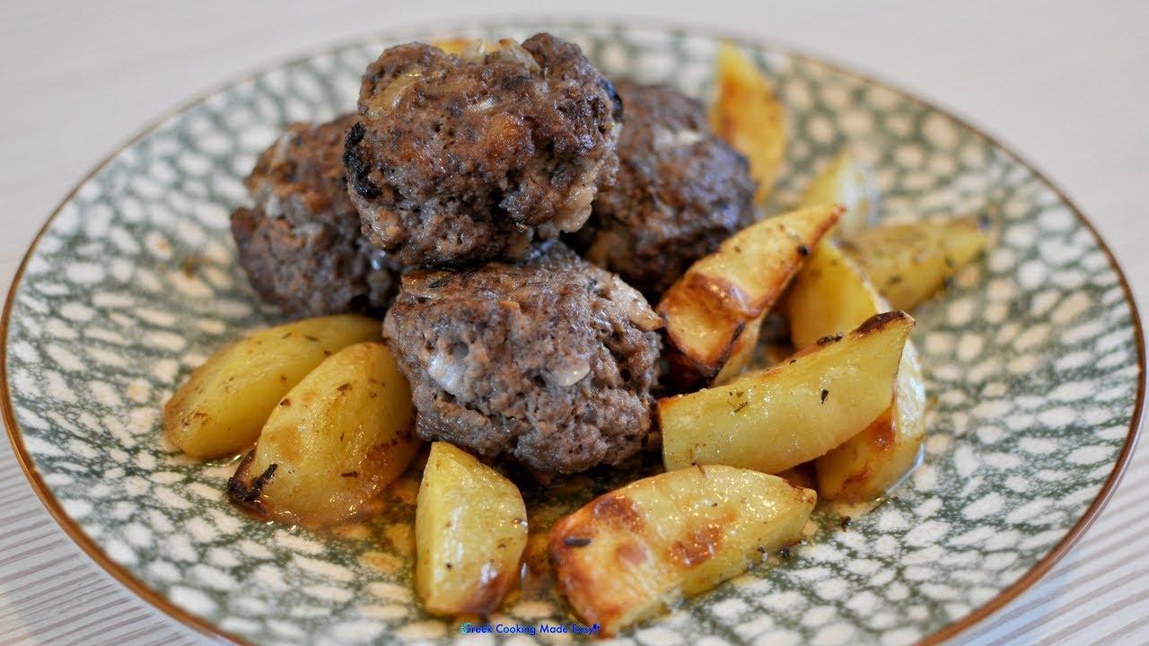 Baked Biftekia with potatoes and lemon