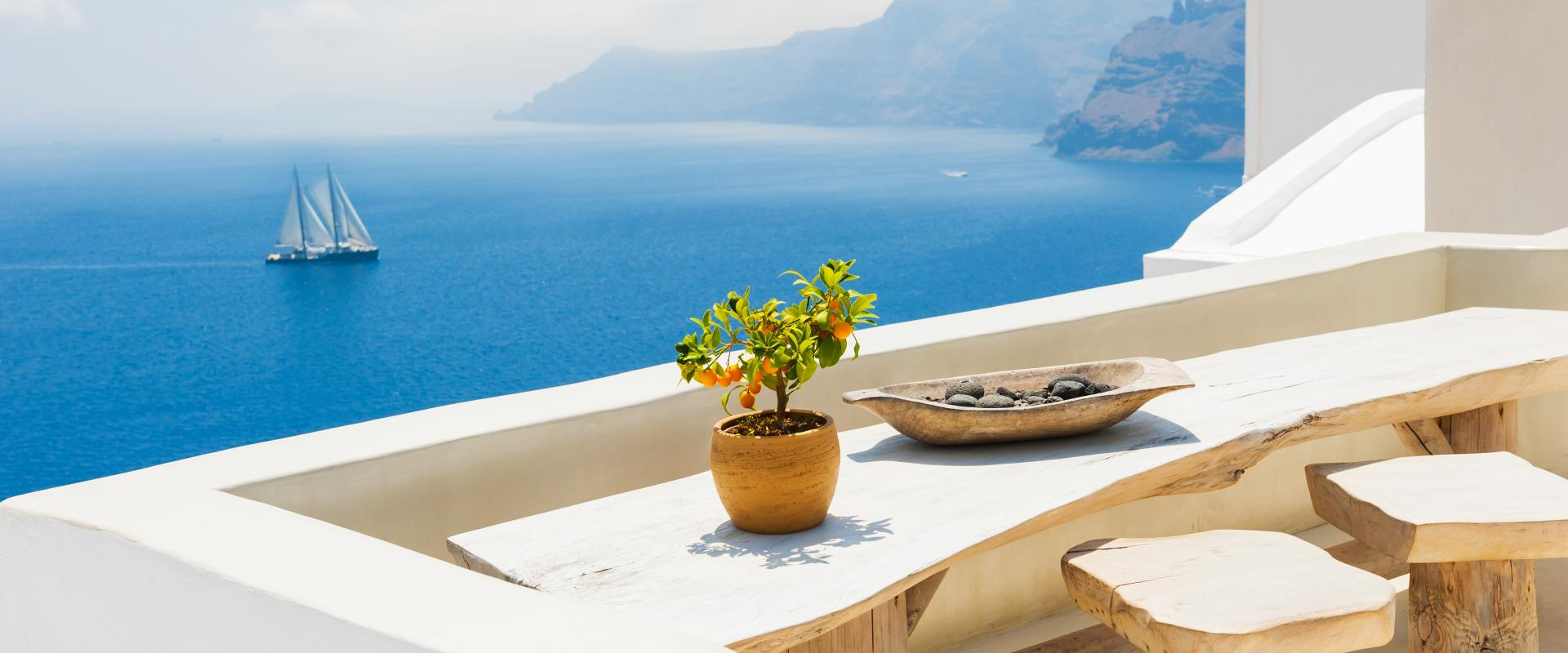 Table on a greek island by the sea with greek products
