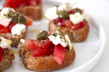 Greek dish with tomatoes, feta, olives, olive oil and greek paximadi